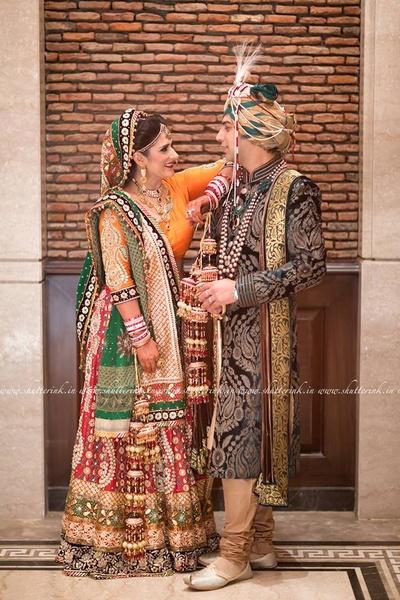Designed mixed match wedding lehenga embellished with gotta patti motifs, accessorized with gold-polki jewellery