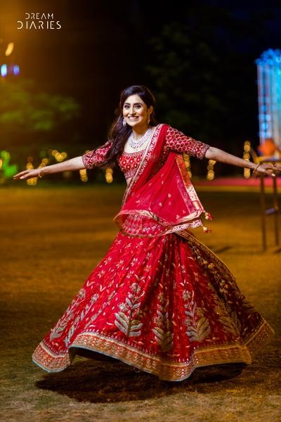 Bride twirls in her designer wear lehenga