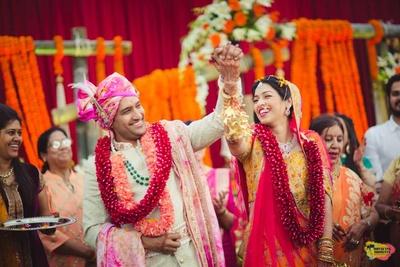 post varmala candid shot of the bride and groom