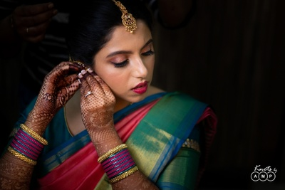 a shot of the bride getting ready for  her pre wedding function