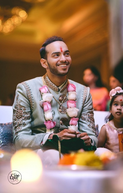 Candid picture of the groom at the mehendi sagan