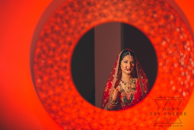 stunning shot of the bride reflected in a mirror
