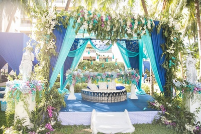 Colorful floral and drapes decor for the  mehendi ceremony.