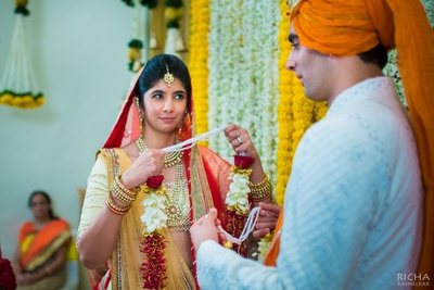 Dressed in elegant lehenga and classy kundan- gold jewellery,  Nirvi easily makes it for one of the most natural brides