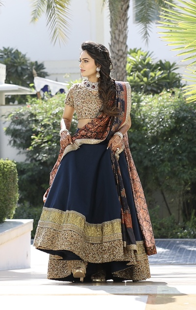 Loving the bride's navy and golden lehenga with statement jewellery for the myra
