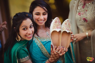 Bridesmaids during the jooti churayi captured by Movie'ing Moments