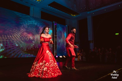 Brother sister duo dressed in coordinated colors for the sangeet ceremony