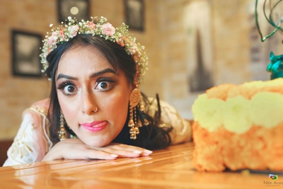 Quirky bridal portraits of the bride during the mehendi ceremony