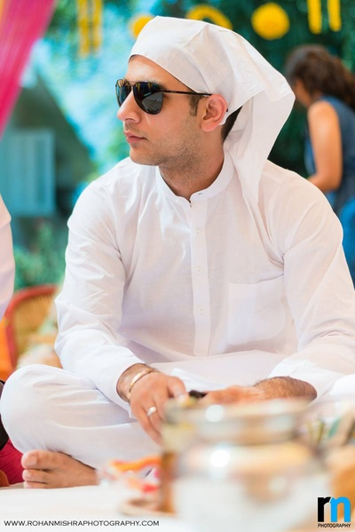 White cotton kurta and churidaar for the haldi ceremony to let those colors show