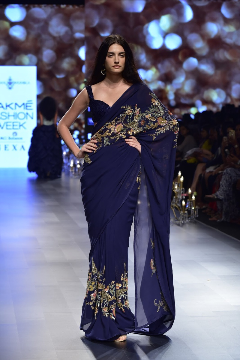8. A navy blue saree with light floral embroidery making a statement!