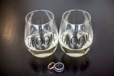monogrammed glasses placed along with the wedding rings