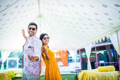 Bride and groom pose together during the haldi function photoshoot