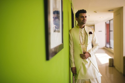 Sagar dressed up in an off white bandhgala kurta paired with white jacket and white dhoti. Styled with multi stringed pearl neck piece.