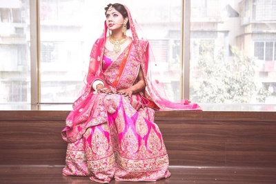 Pink embellished bridal lehenga by Diva'ni Clothing Store, Mumbai