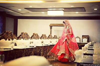 Majestic flared red and gold bridal lehenga, embellished with gold sequins featuring an embroidered border