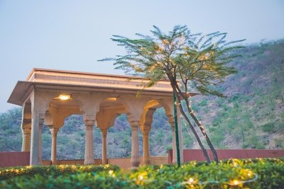 Plush Neemrana Fort Palace decorated with fairy lights for an evening function