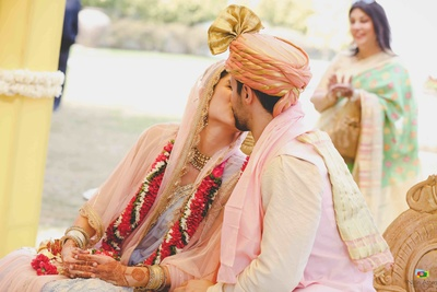 Natasha and Derek captured during an intimate moment at the wedding mandap