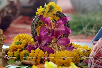 Idols showered with Marigold and Hibiscus flowers for pooja ceremony