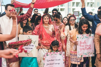 the bride making an entry with her family beside her