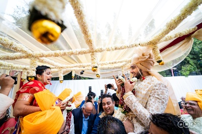 The couple having a gala time during the varmala ceremony.