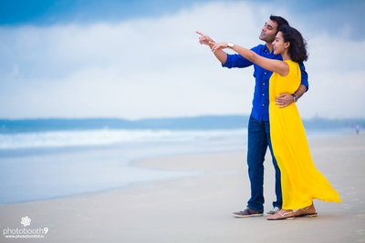 Outdoor pre wedding photo shoot by the beach dressed in smart casual outfits
