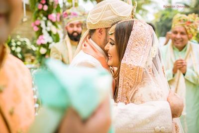 Bride and groom enter the wedding mandap together