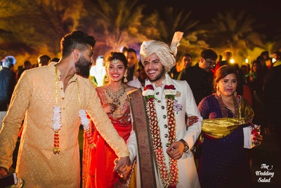 Groom being escorted by the brother of the bride, Kunal Rawal