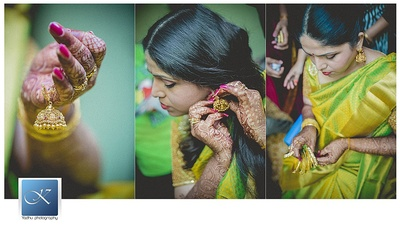Getting ready for her big day in a parrot green kanjeevaram silk saree and gold jhumkas