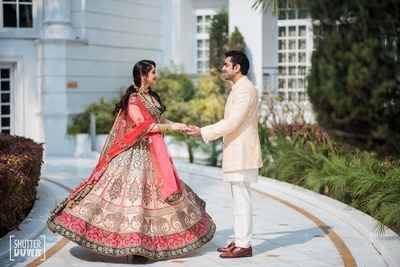 Twirling bride in her beautiful lehenga with the groom during their sangeet function at Hotel Renaissance, Lucknow
