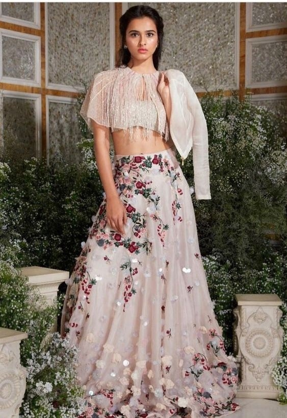 5ee7c0d206a5 Paired with a beautiful and flowy lehenga is a cape choli, which gives the  traditional bridal lehenga a fun and modern twist. These types of bridal  lehengas ...