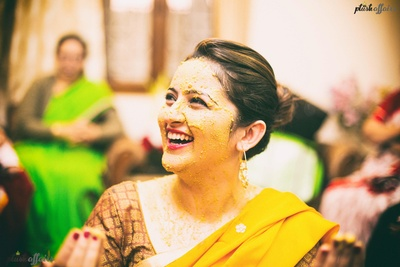 Our beautiful bride all drenched in haldi on her haldi ceremony .