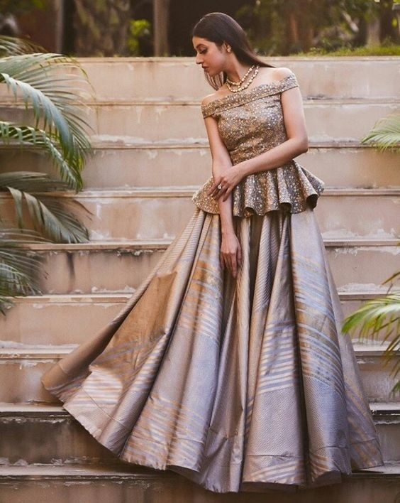 8a19afe0910408 A trending lehenga design of 2018, the peplum choli and flared lehenga  combo work well together and give a modern and edgy look to your bridal  ensemble.