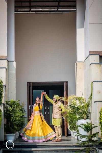 twirling bride in her yellow lehenga on her mehendi day