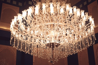 Opulent crystal chandelier at the grand destination wedding venue- Hotel Fairmont.