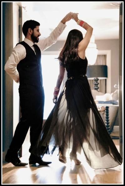 Black floor length dress styled with a black matching waist belt