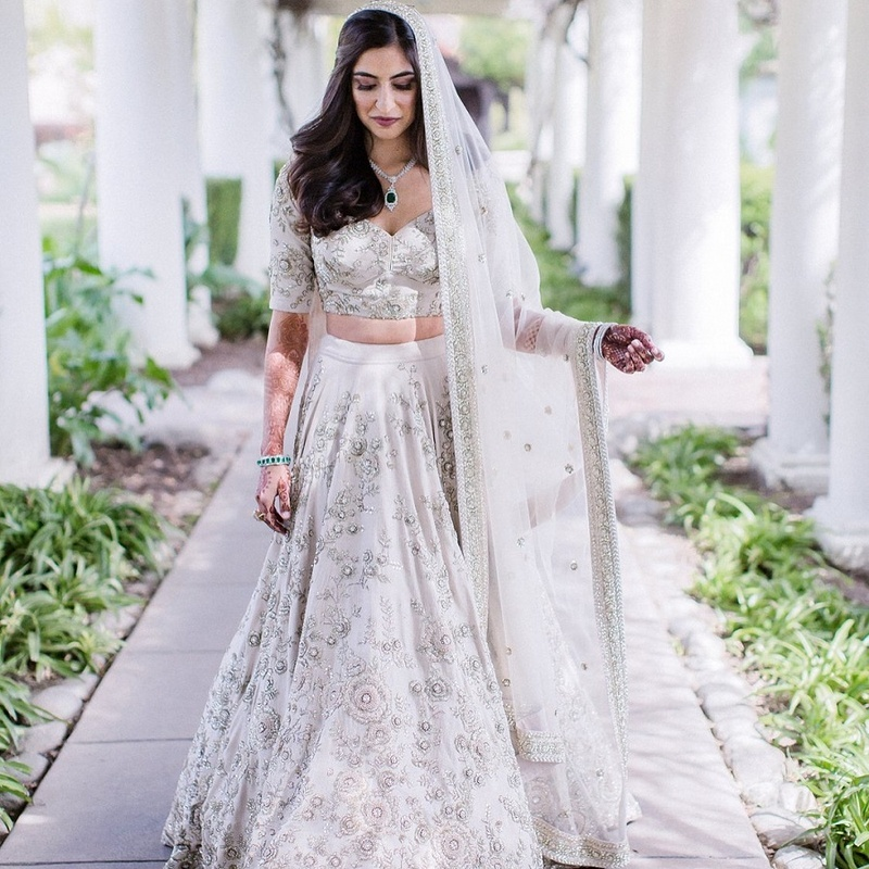 41c226065 I am stunned by the sheer elegance of this bride's lehenga. She chose to  wear an all-white lehenga with lilac undertones and placed motifs to take  her ...