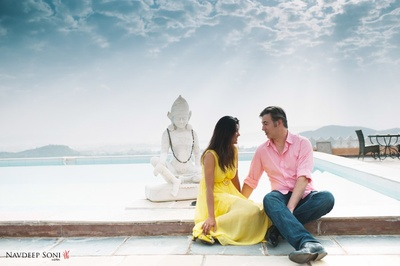 Dressed in buttery yellow dress and pink linen solid shirt for a pre wedding photoshoot
