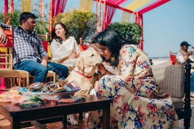 Intimate mehendi ceremony attended by the bride's dog