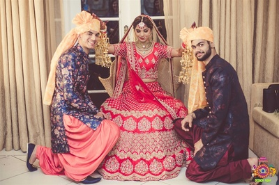 Quirky picture of the bride with her brothers