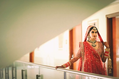 The bride is slaying it in her red Sabyasachi lehenga!