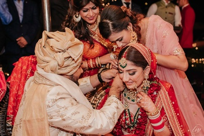 The groom tying mangal sutra to the bride