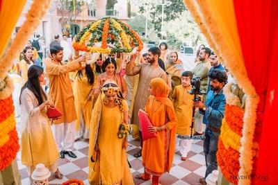 The traditional bride entering her haldi ceremony