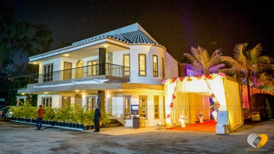 Venue decorated with flowers and lights for the wedding celebrations