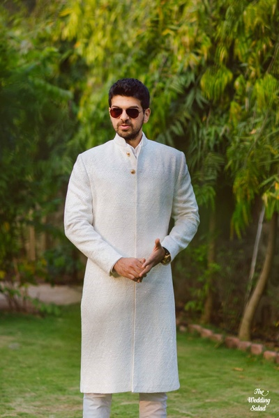 Groom's singular portrait in his traditional sherwani before the wedding function