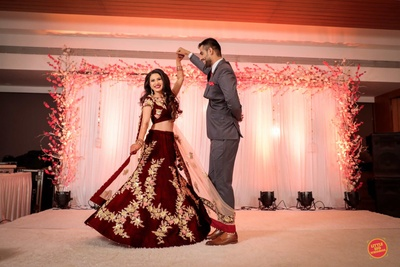 The groom twirling his bride on their sangeet
