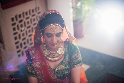Bridal make up styled with kundan and moti jewellery for her big day