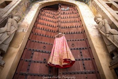 Bridal lehenga photography at Neemrana fort palace location by Gautam Khullar.