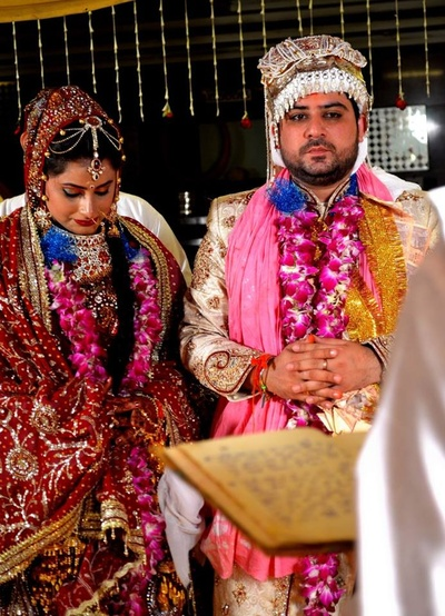 Indian bridal couple wearing traditional ethnic outfits