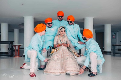 Bride and her brothers posing together in a family photoshoot