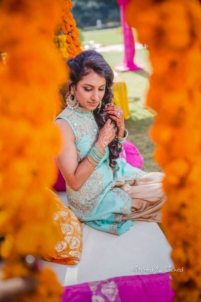 Bride Garima poses for Hitched and Clicked during the mehndi ceremony